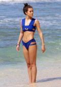 Montana Brown wears a blue bikini at the beach while on holiday in Barbados