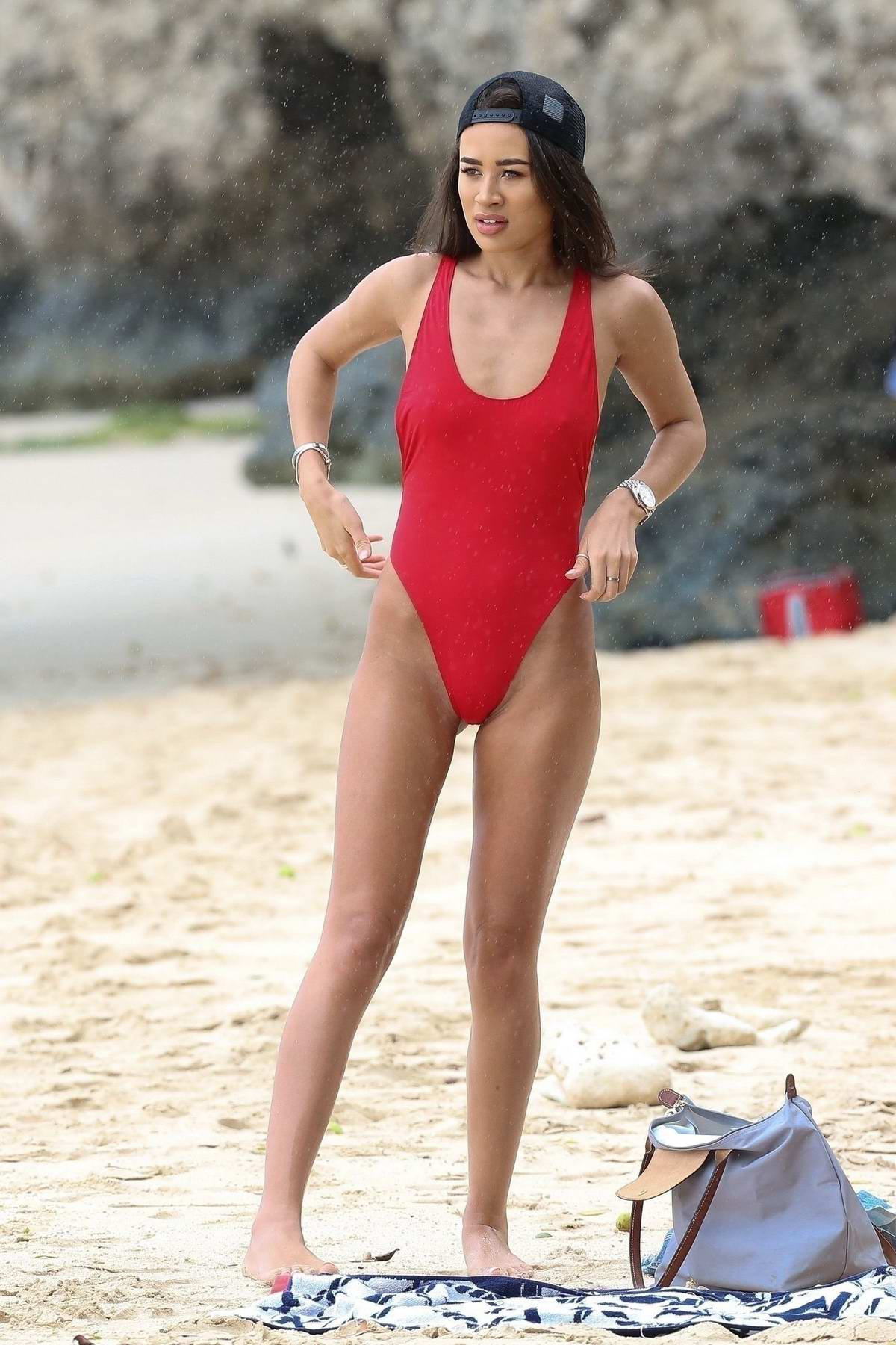 Montana Brown wears a red swimsuit while enjoying the beach in Barbados