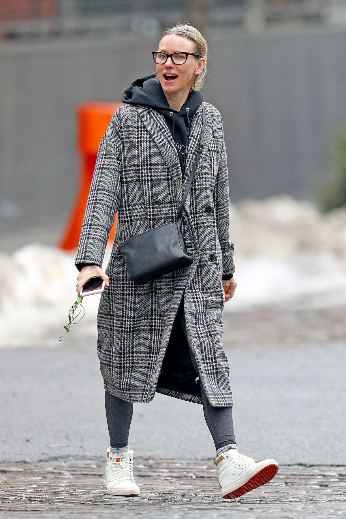 Naomi Watts takes a stroll bundled up in a plaid trench coat in New York City
