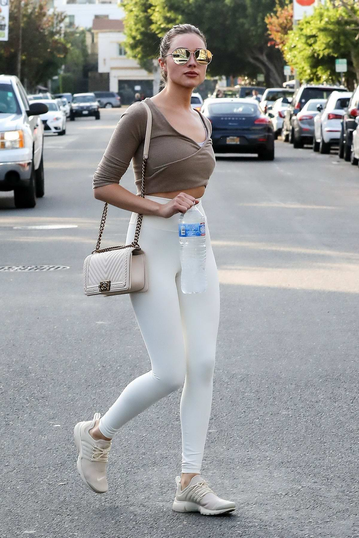 Olivia Culpo looks stunning in a brown top and white leggings while out in West Hollywood, Los Angeles