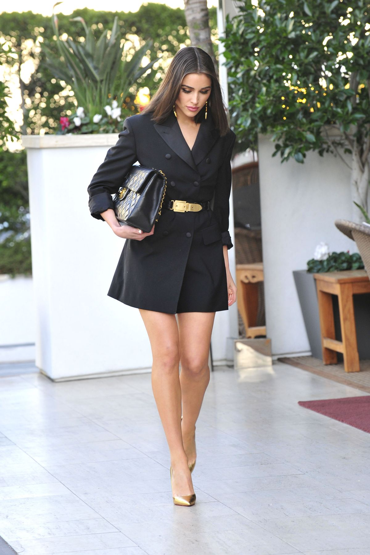 Olivia Culpo steps out in a black and gold ensemble in Los Angeles