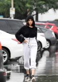 Olivia Culpo steps out in the rain wearing a black hoodie for some grocery shopping in Los Angeles