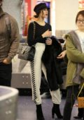 Olivia Culpo wears a monochrome outfit as she makes her way through LAX Airport in Los Angeles