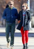 Olivia Wilde wears puffer jacket and bright red leggings while out with Jason Sudeikis on a cold day in New York City