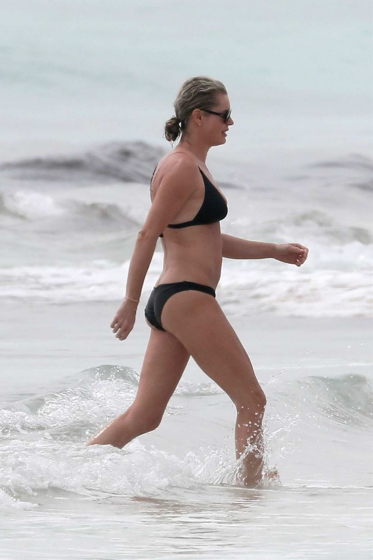 Rebecca Romijn enjoying New Year's Day on the beach in a black bikini in Tulum, Mexico