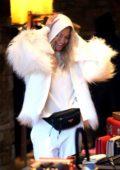 Rita Ora dressed in all white winter attire as she shops at Prada in Aspen. Colorado