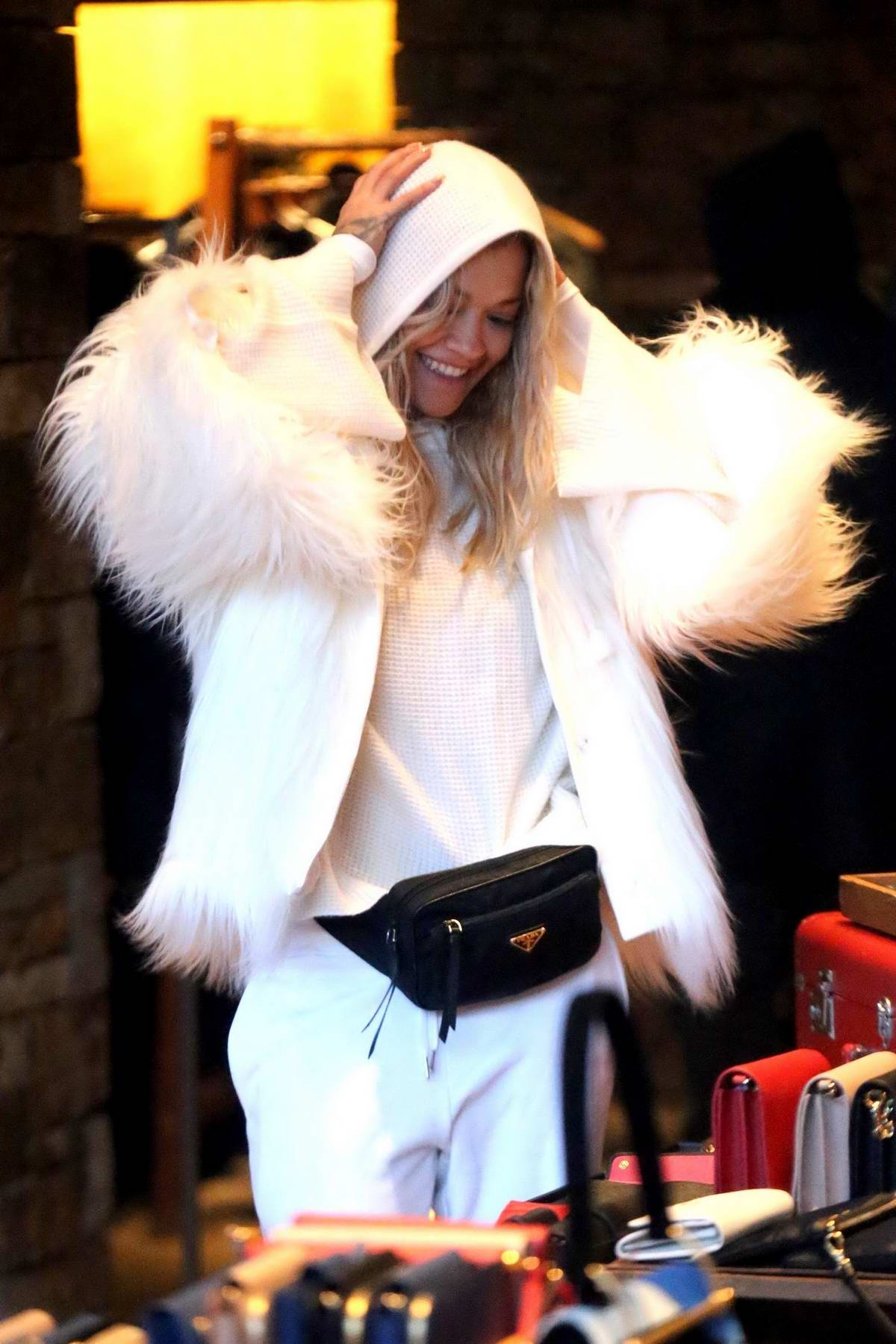 Rita Ora dressed in all white winter attire as she shops at Prada in Aspen. Colorado