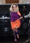 Rita Ora in a purple and orange ensemble arrives at the Chanel store in Paris, France