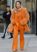 Rita Ora rocks all orange as she heads out for the day in New York City