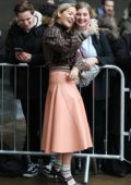 Rita Ora take selfies with her fans outside BBC Radio in London