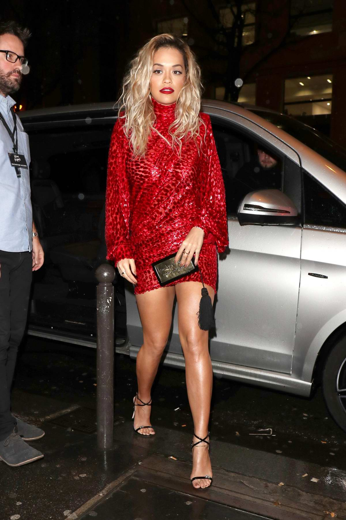 Rita Ora wearing a red short dress as she heads out in Paris, France