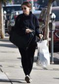 Rooney Mara dressed in all black, shops at International Silks & Woolen in Studio City, Los Angeles