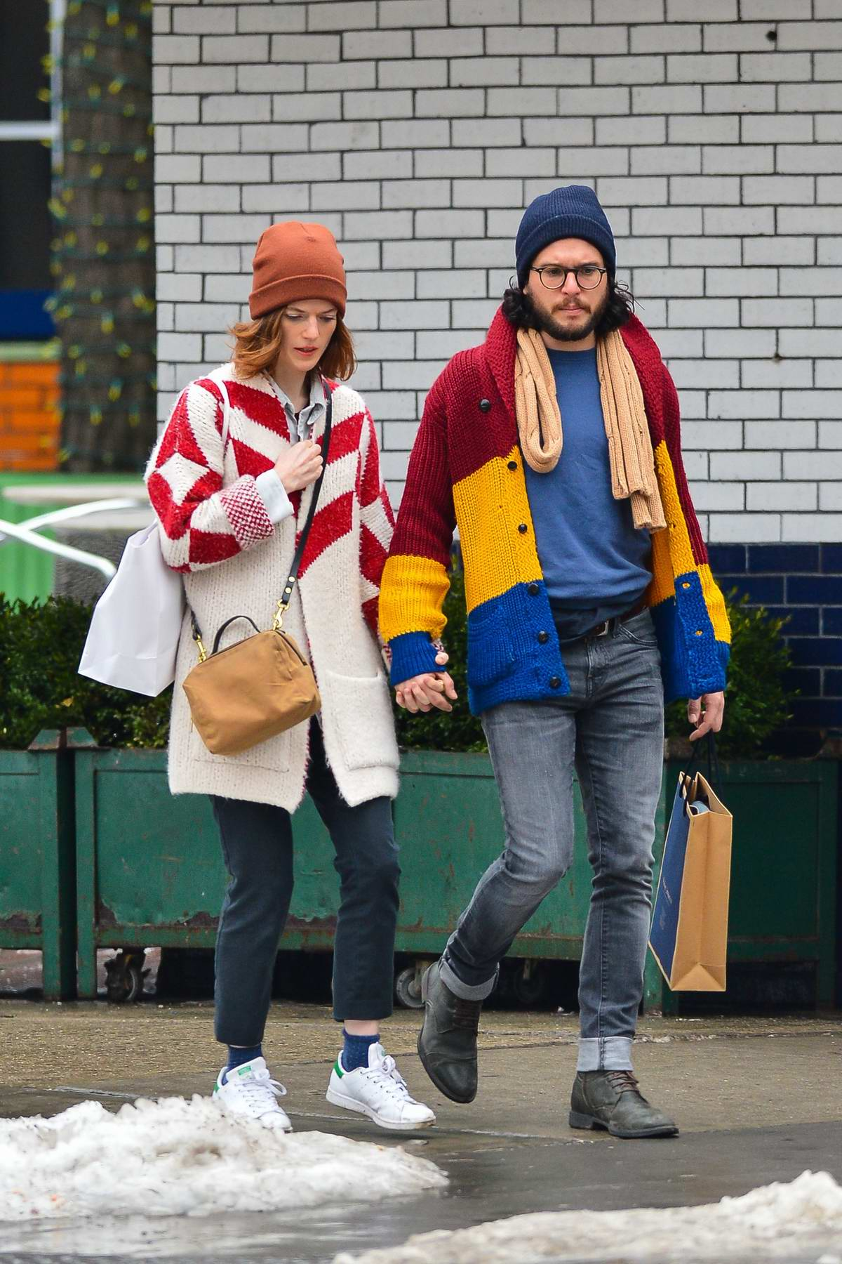 Rose Leslie and Kit Harington hold hands as they go for a stroll in New York City