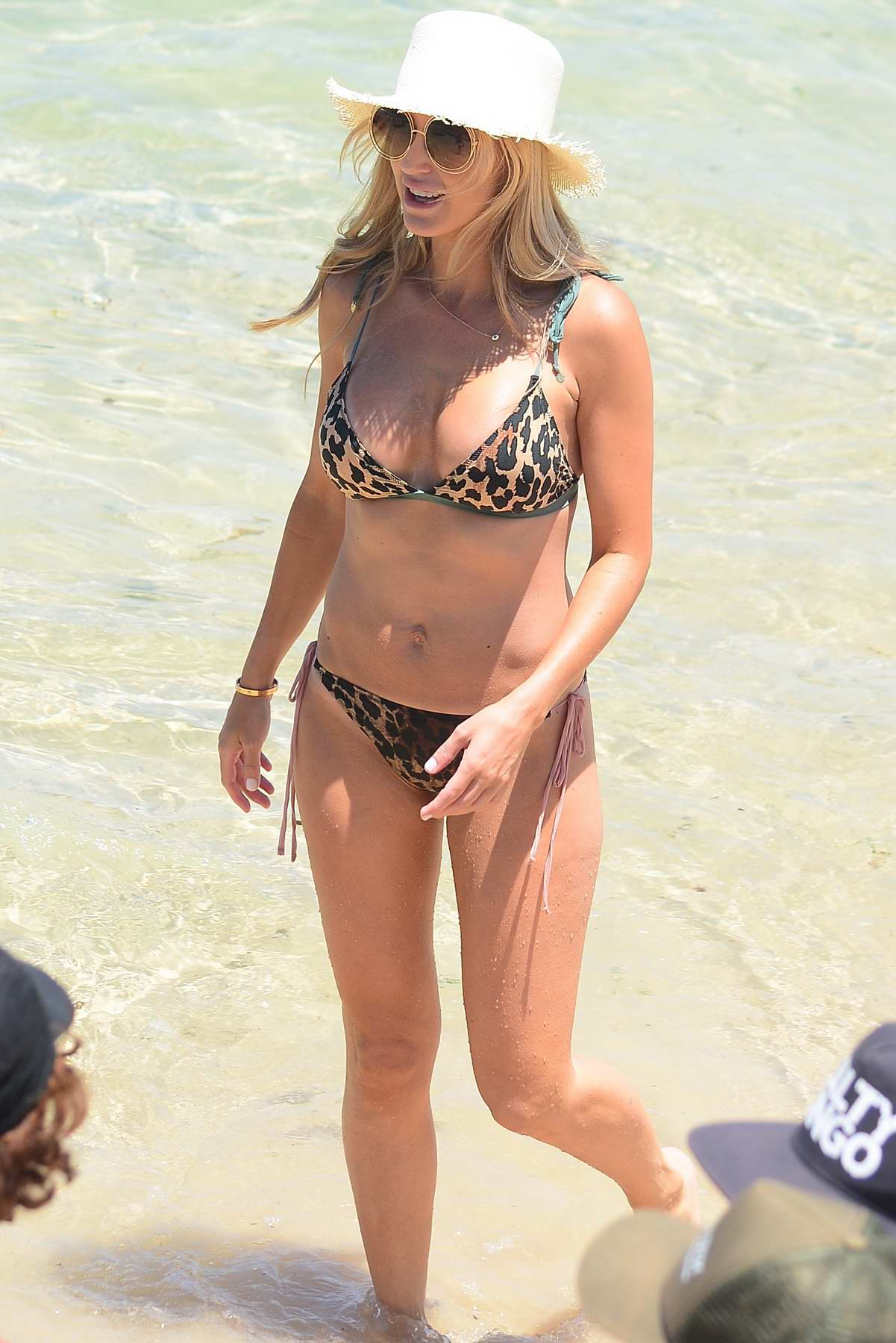 Roxy Jacenko in a leopard print bikini enjoys a day with her family at Bondi beach in Sydney, Australia
