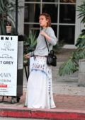 Rumer Willis waits for her car after a visit to Alfred Coffee on Melrose Place in West Hollywood, Los Angeles