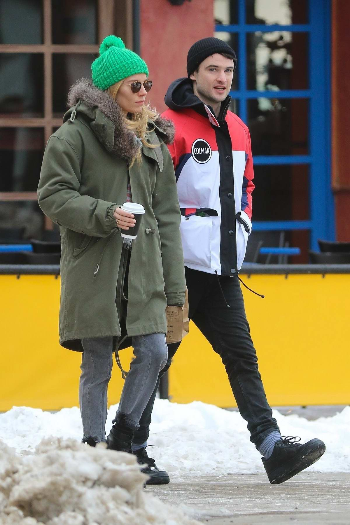 Sienna Miller and Tom Sturridge grabs a coffee after dropping off their daughter at school in New York City