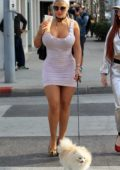 Sophia Vegas Wollersheim takes her dog for a walk after enjoying lunch at Il Pastaio in Beverly Hills, Los Angeles