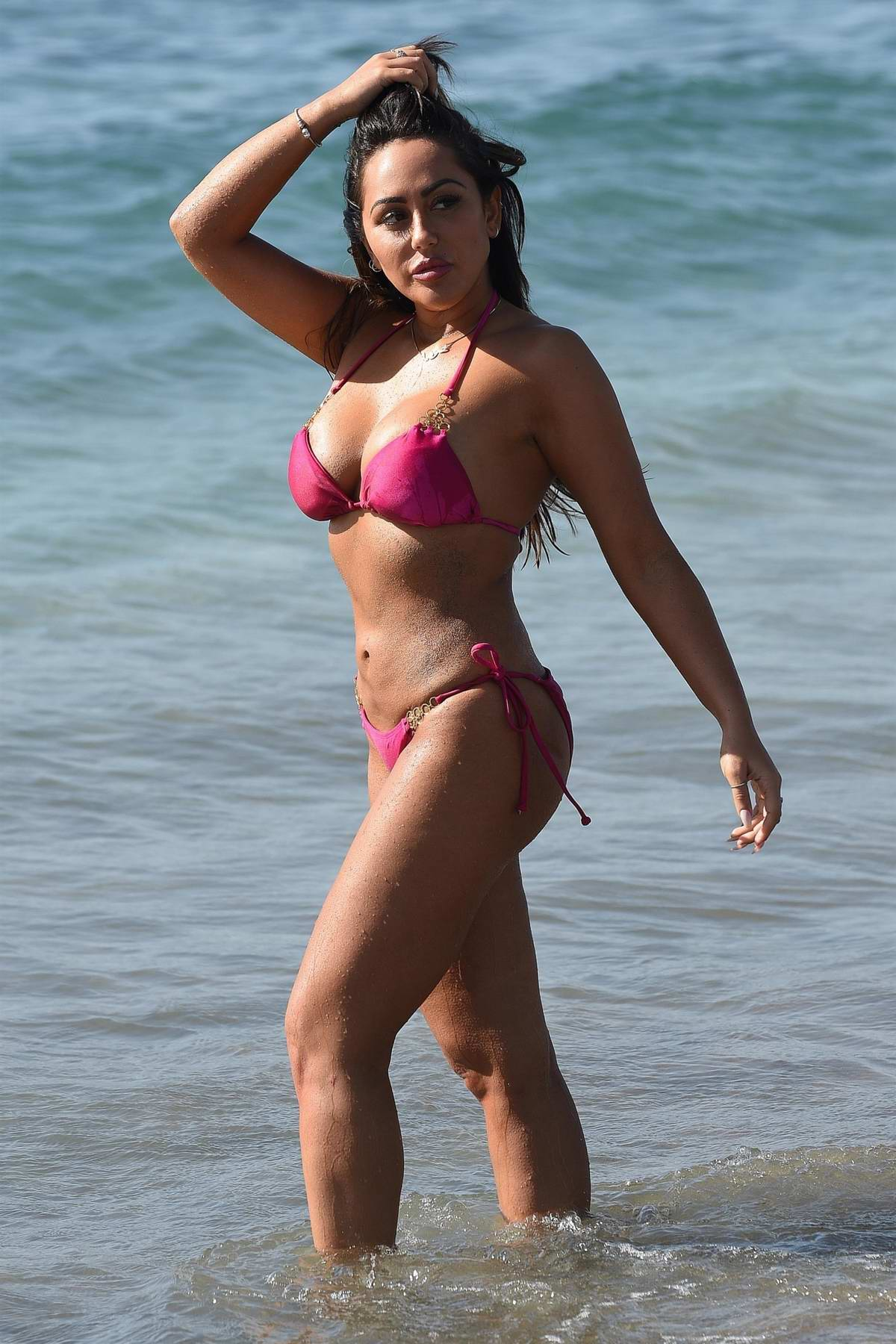 Sophie Kasaei spotted on the beach in a pink bikini in Lanzarote, Spain