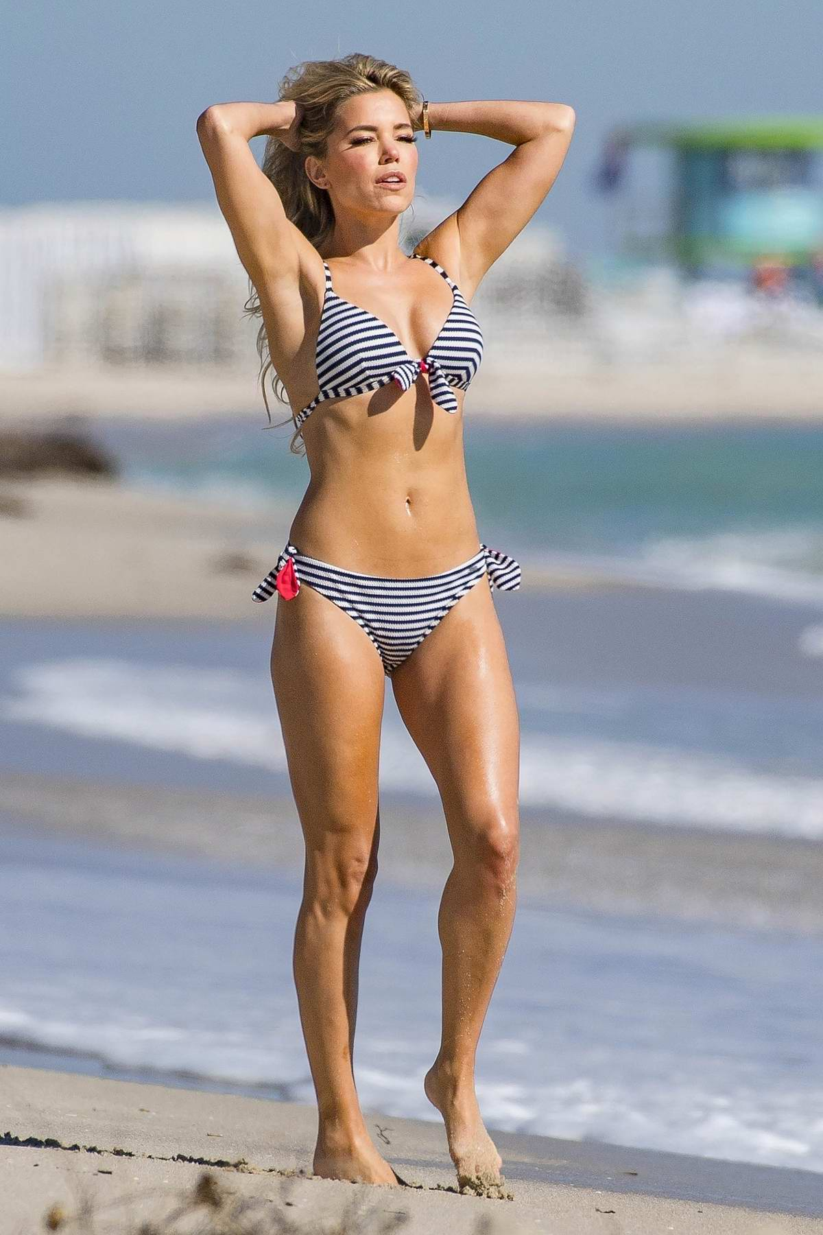Sylvie Meis dons assorted bikinis as she shoots for her new Sylvie Designs bikini collection on Miami beach, Florida