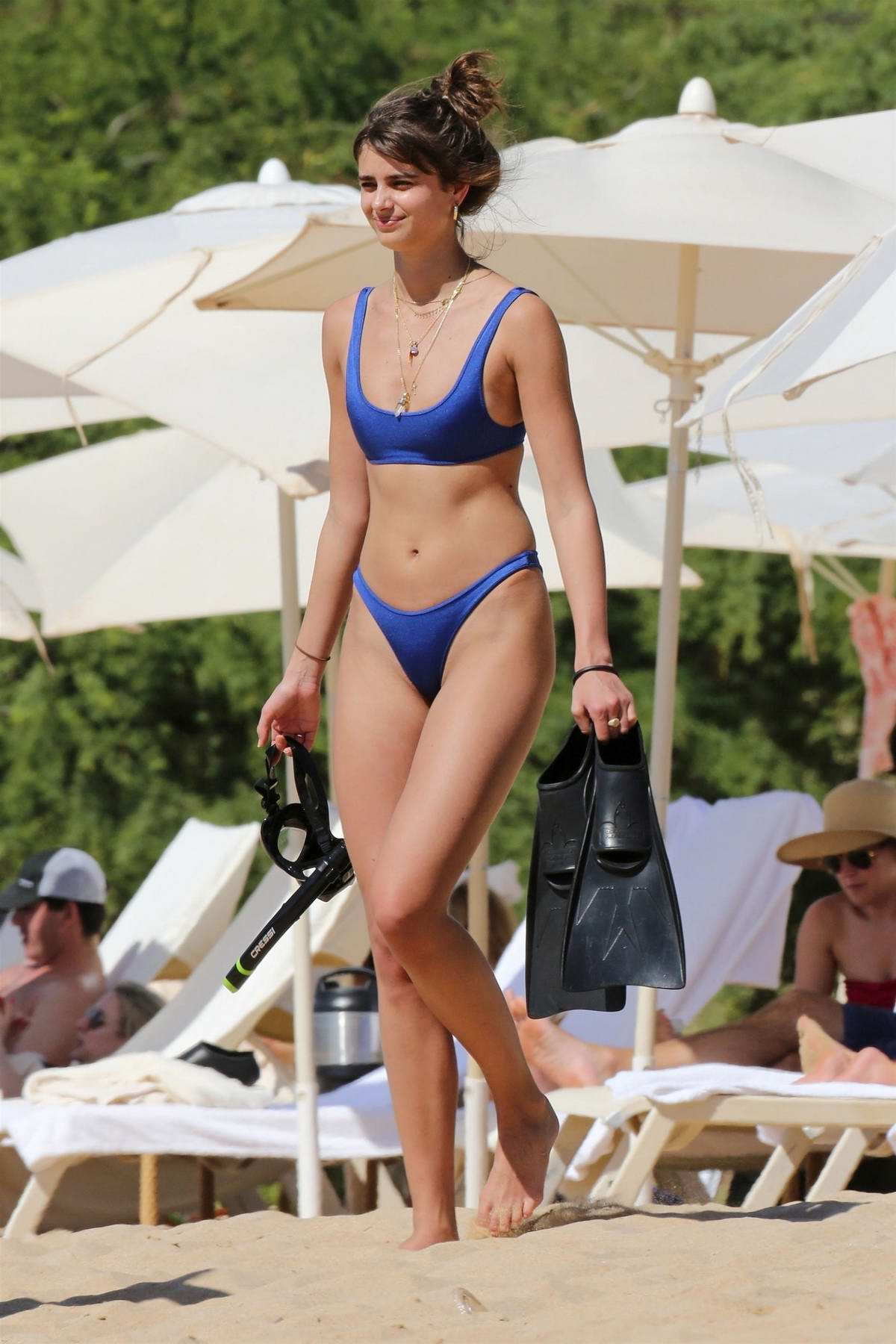 Taylor Hill hits the beach in a blue bikini during her holidays in Hawaii