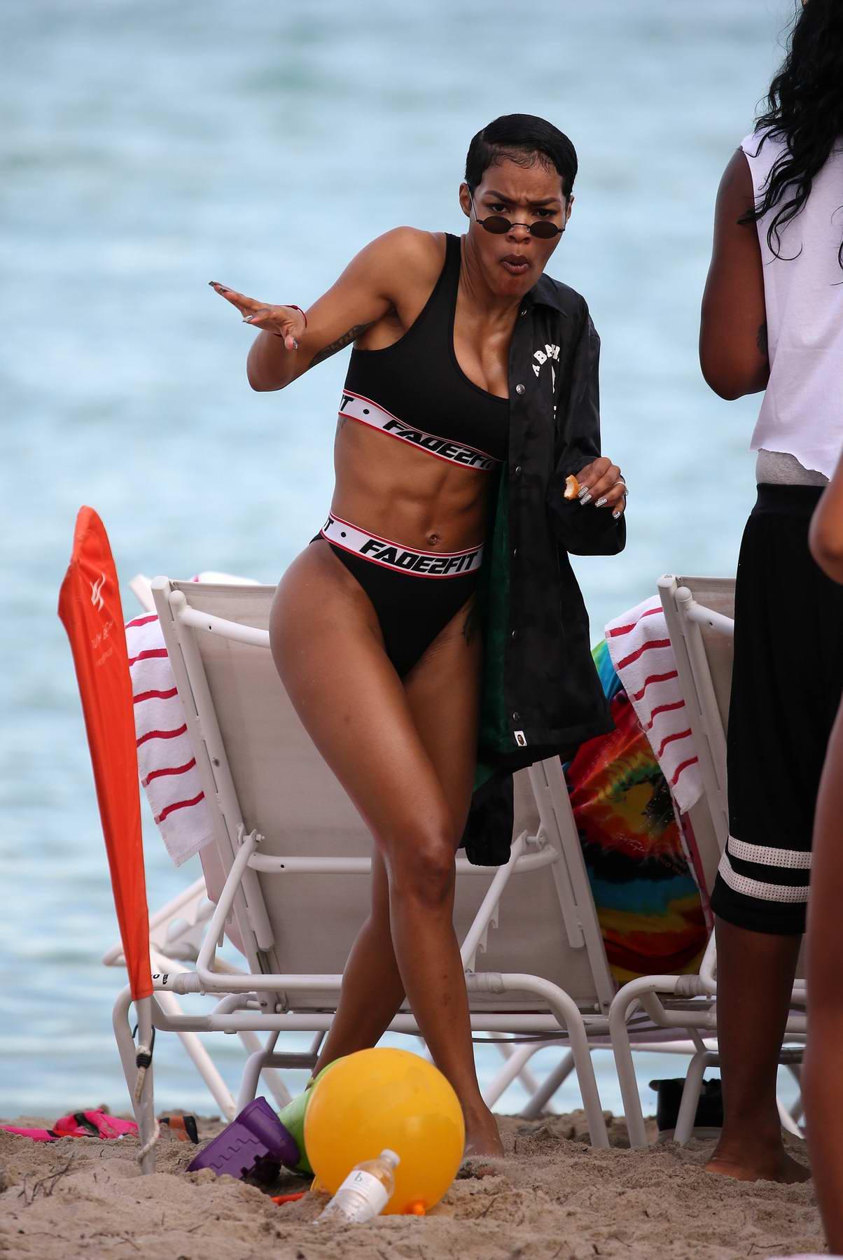 Teyana Taylor shows off her washboard abs as she hits the beach in black bikini in Miami, Florida