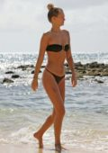 Toni Garrn wears a bikini as she spends a day relaxing at the beach in Hawaii