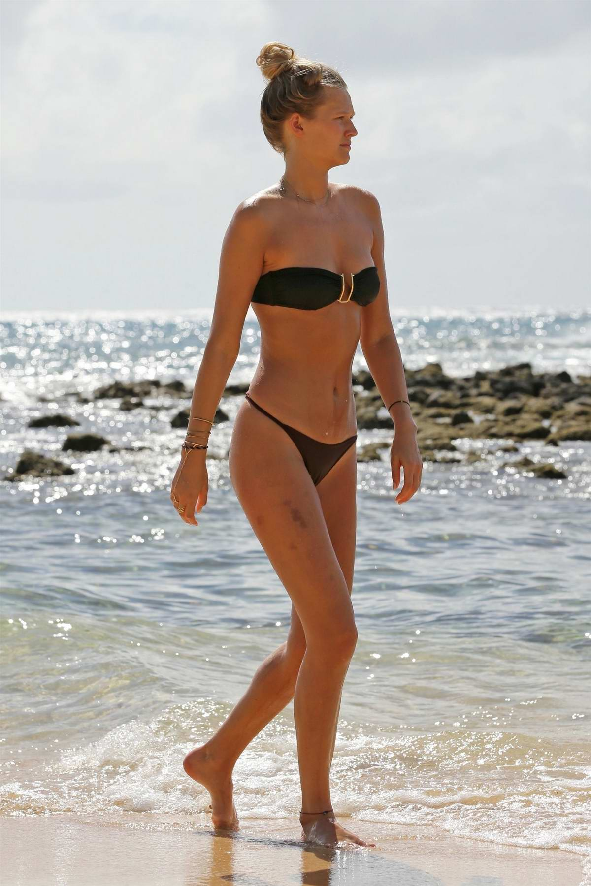 Toni Garrn wears a bikini as she spends a day relaxing at the beach in Hawaii