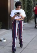 Vanessa Hudgens dressed in a cropped 'FEMINIST' T-shirt paired with striped pants and a beret as she runs errands on Melrose Place, Los Angeles
