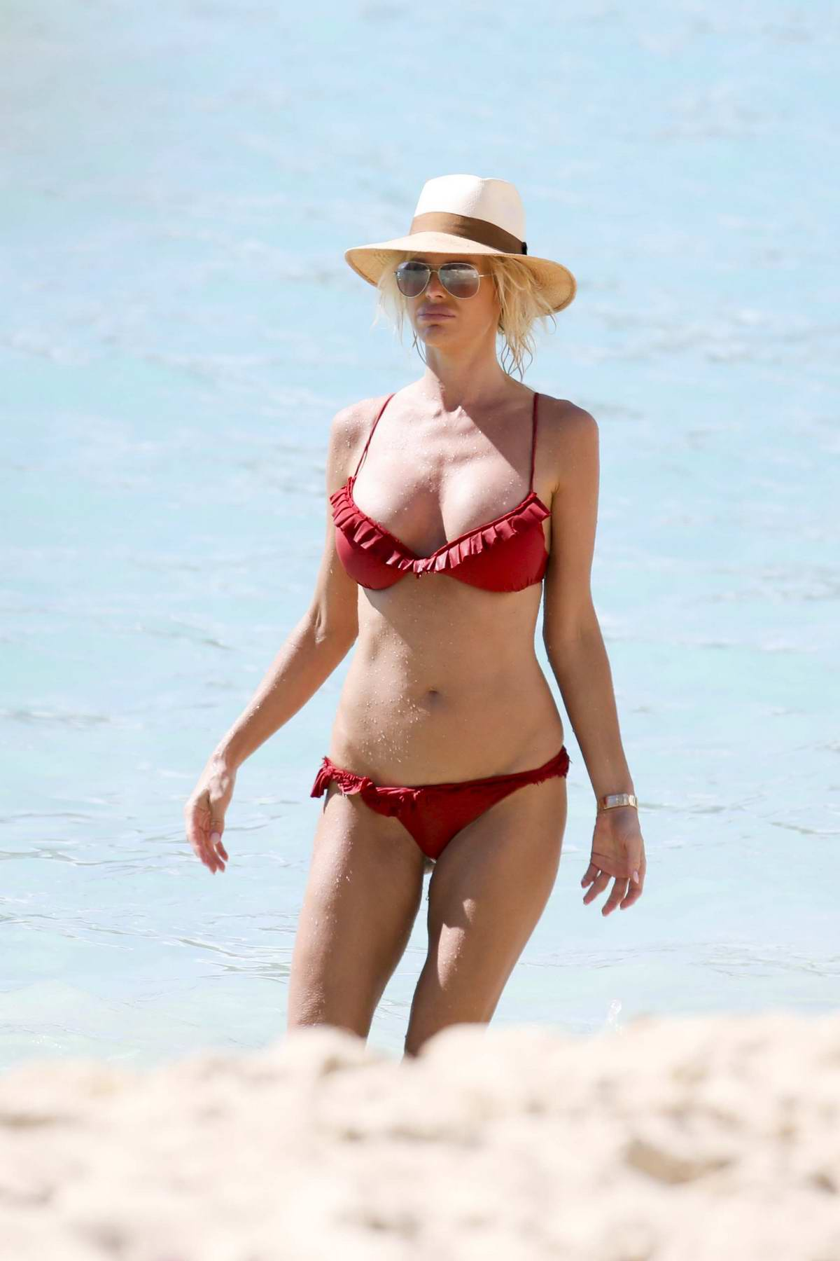 Victoria Silvstedt spotted in a red bikini while relaxing on the beach in St Barts, France