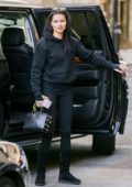 Adriana Lima is casual cute in an all black outfit seen out running errands in New York City