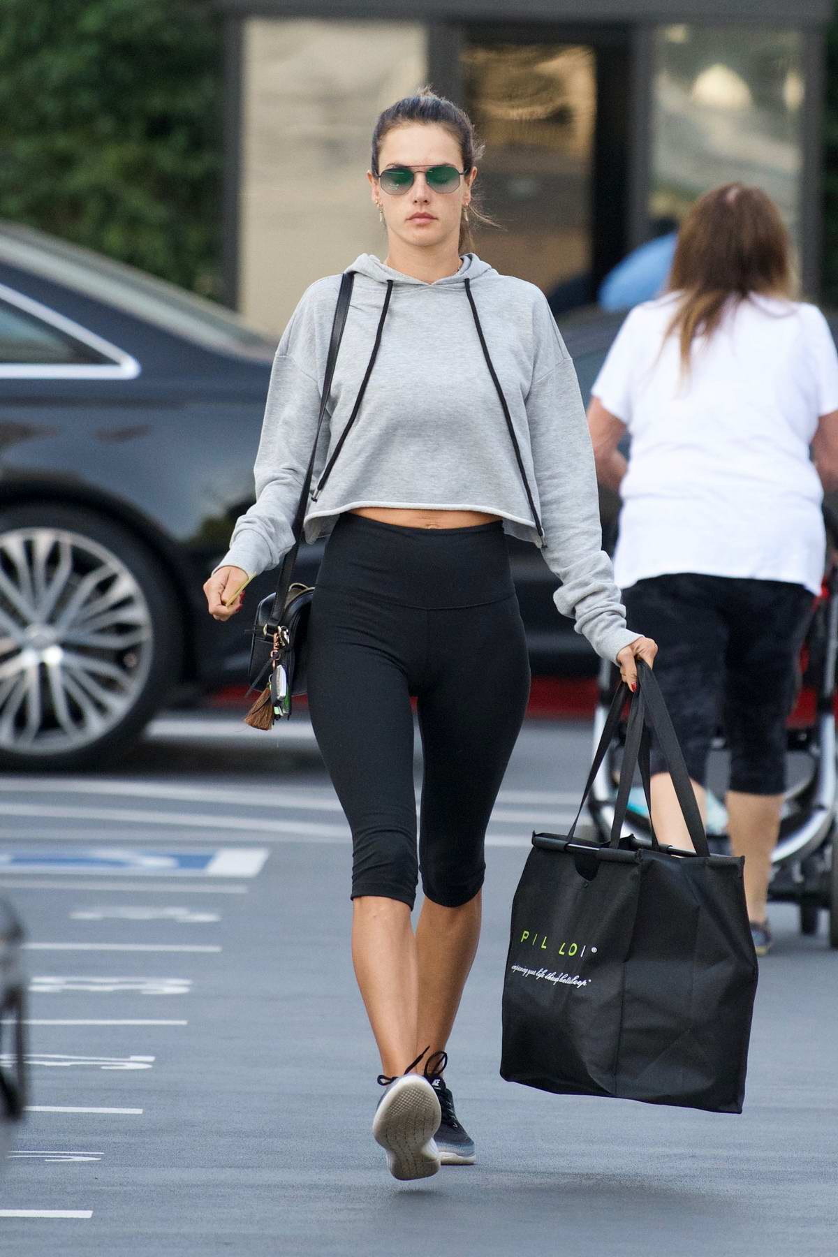 Alessandra Ambrosio steps out in cropped grey hoodie and capri leggings to run errands in Los Angeles