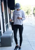 Alessandra Ambrosio wears 'Live Local' sweatshirt and leggings while out on an errand in Brentwood, Los Angeles