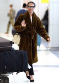 Alicia Vikander spotted wearing a comfy brown fur coat as she arrives at JFK airport in New York City