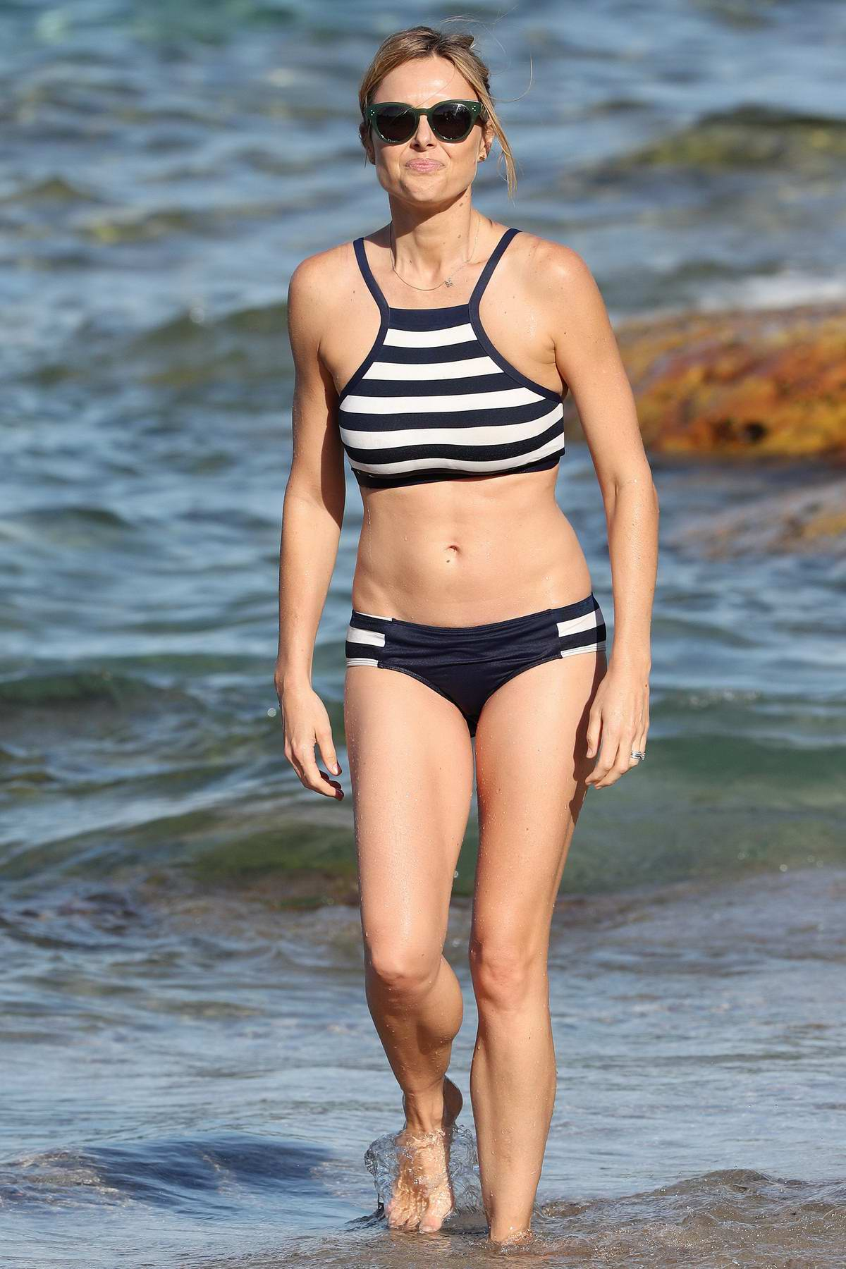 Allison Langdon wears a striped bikini while enjoying a beach day with her family in Sydney, Australia