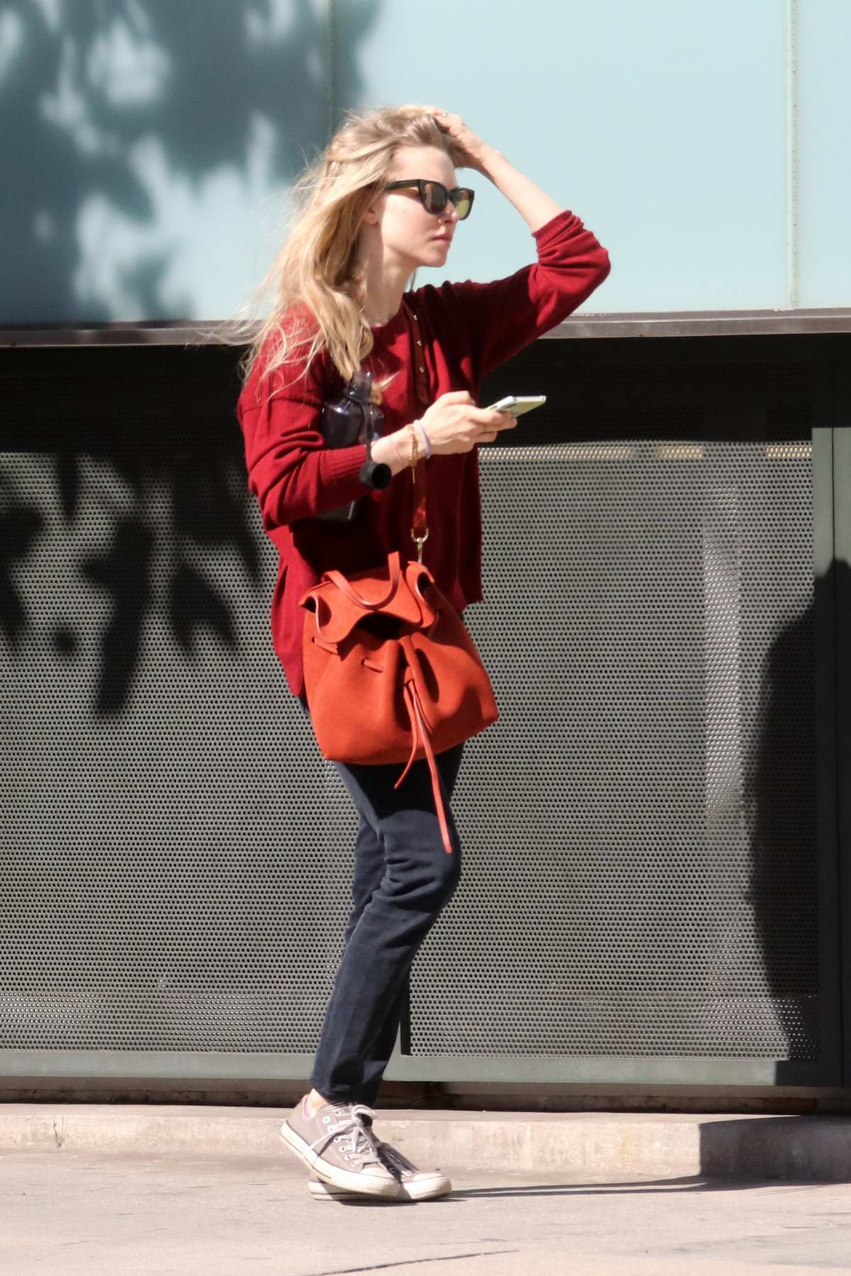 Amanda Seyfried spotted out and about wearing a red sweater and black jeans in Beverly Hills, Los Angeles