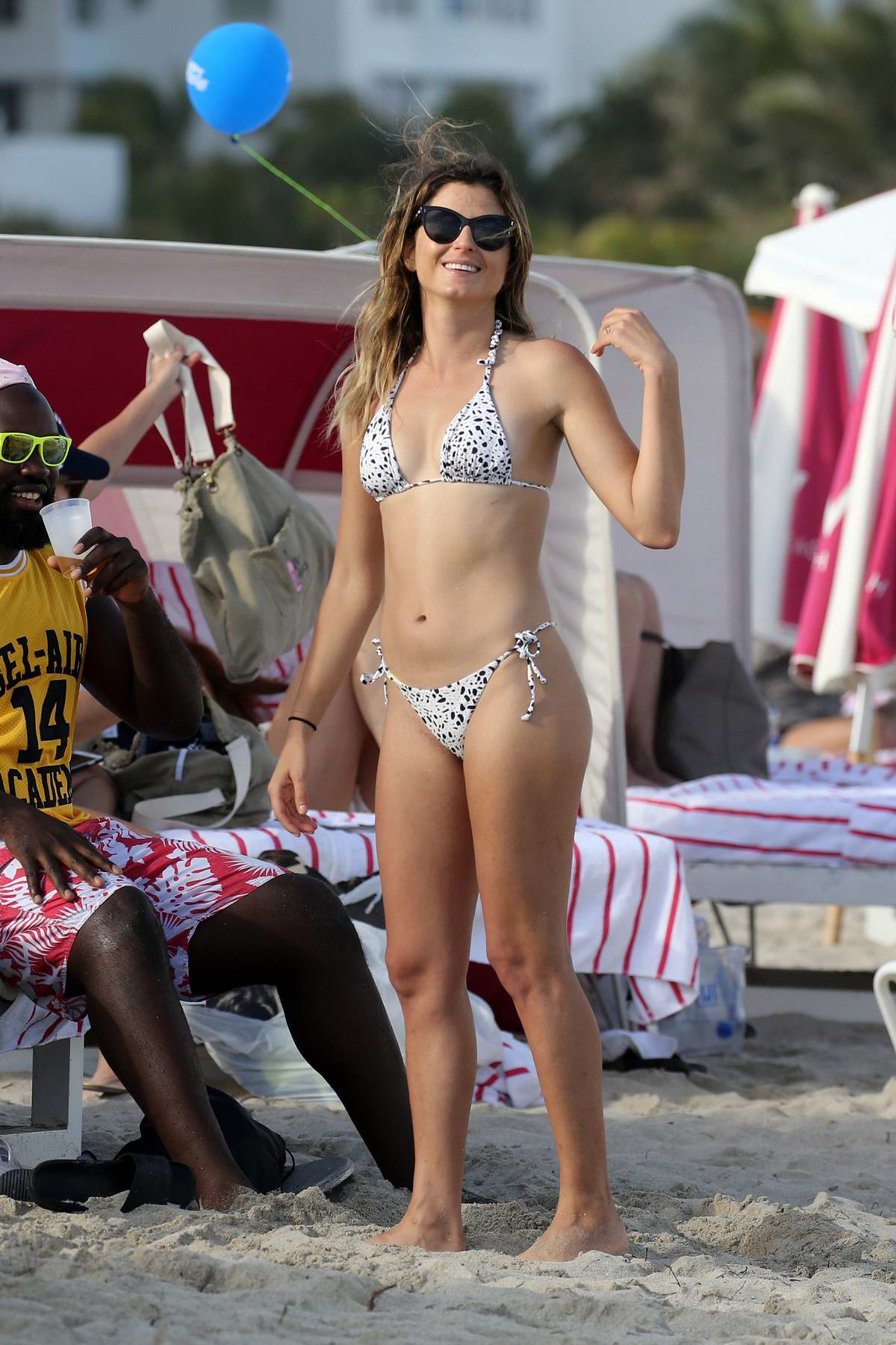 Anastasia Ashley wears a string bikini while she spends a day on the beach with her boyfriend in Miami, Florida