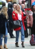 Ashley James spotted with red roses on Valentine's Day as she steps out in a bright red coat, pink top and jeans in London