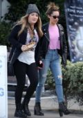 Ashley Tisdale out with a friend wearing a black leather jacket and jeans in Venice, Los Angeles