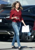 Ashley Tisdale wears a red shirt and jeans as she visits a studio in Venice, California