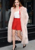 Bailee Madison wears a full length fur coat while she visits AOL Build Studios in New York City