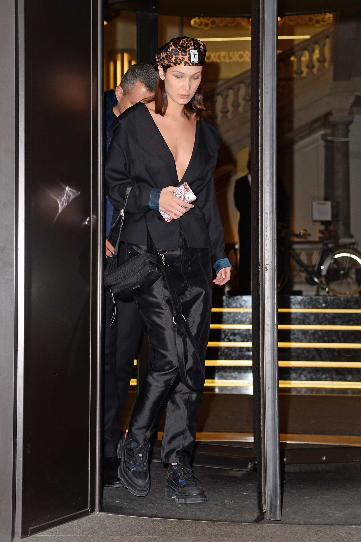 Bella Hadid leaves her hotel wearing an all black ensemble in Milan, Italy