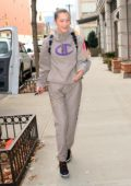 Bella Hadid smiles while on her way to the gym as a photographer takes a dive to the floor, New York City