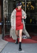 Bella Hadid steps out in red mini dress and PVC cap during Paris Fashion Week, France