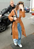 Bella Hadid wearing a brown trench coat as she arrives for Fendi Fashion Show during Milan Fashion Week in Milan, Italy