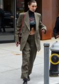 Bella Hadid wears an olive green suit as she leaves sister Gigi's apartment in New York City