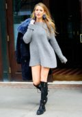 Blake Lively wears a grey sweater dress with knee-high boots and blue fur coat while out in New York City