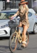 Blanca Blanco shows off her new blonde hairstyle as she enjoy a bike ride along the Venice beach, California