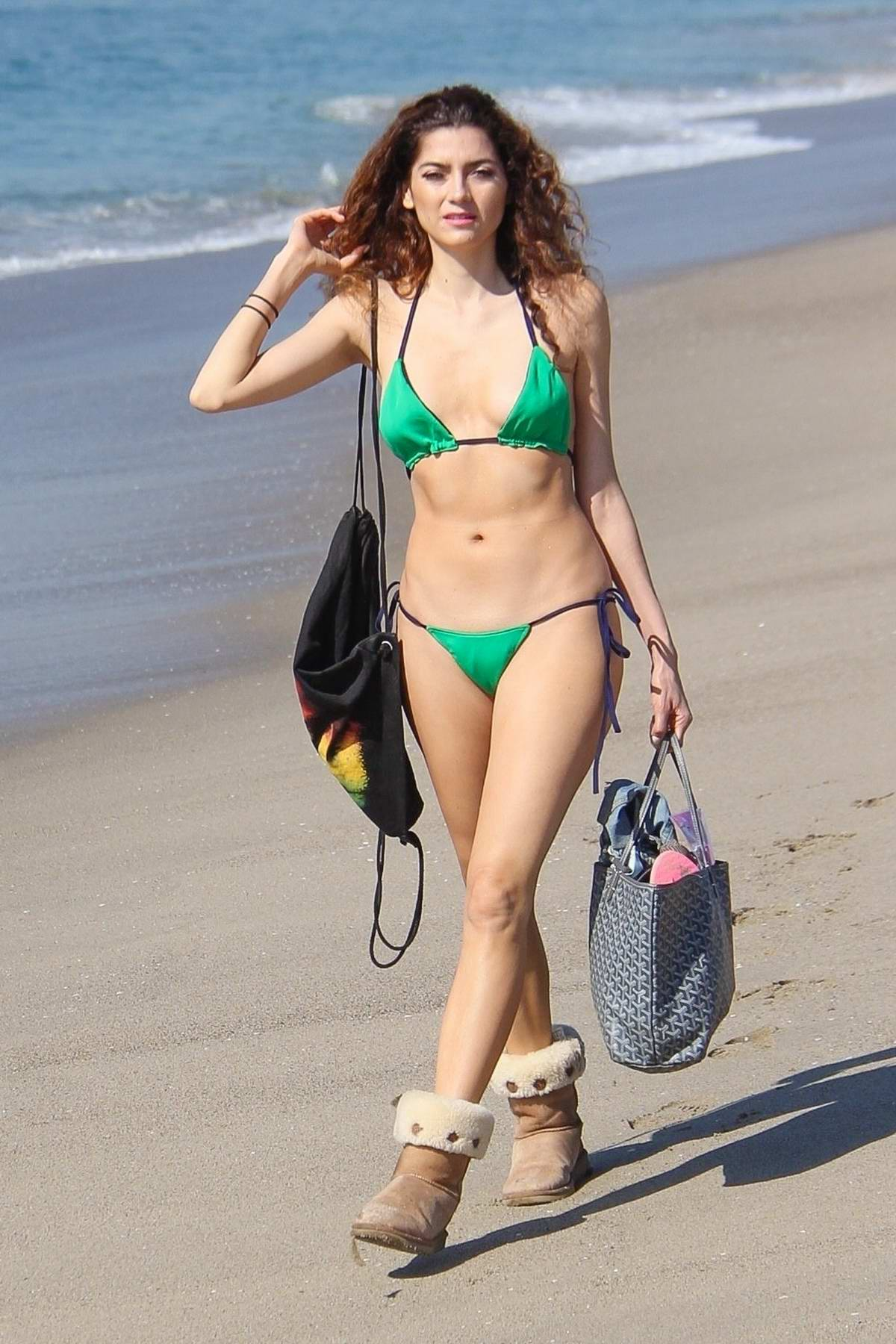 Blanca Blanco spotted walking along the beach wearing a green bikini and ugg boots in Venice beach, California