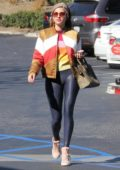 Blanca Blanco stops for a coffee and some frozen yogurt in Malibu, California