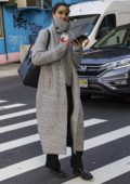 Blanca Padilla keeps warm in a grey long coat over a matching turtleneck while out in Soho, New York City